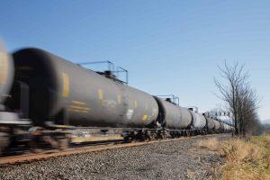 railcars traveling down railroad
