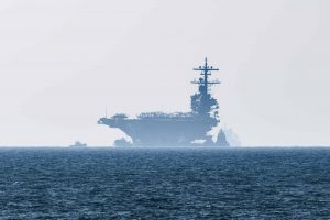 aircraft carrier in the distance